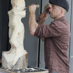 rudolf-sokolovski-in-studio-carving-white-cedar-wood-modern-sculpture